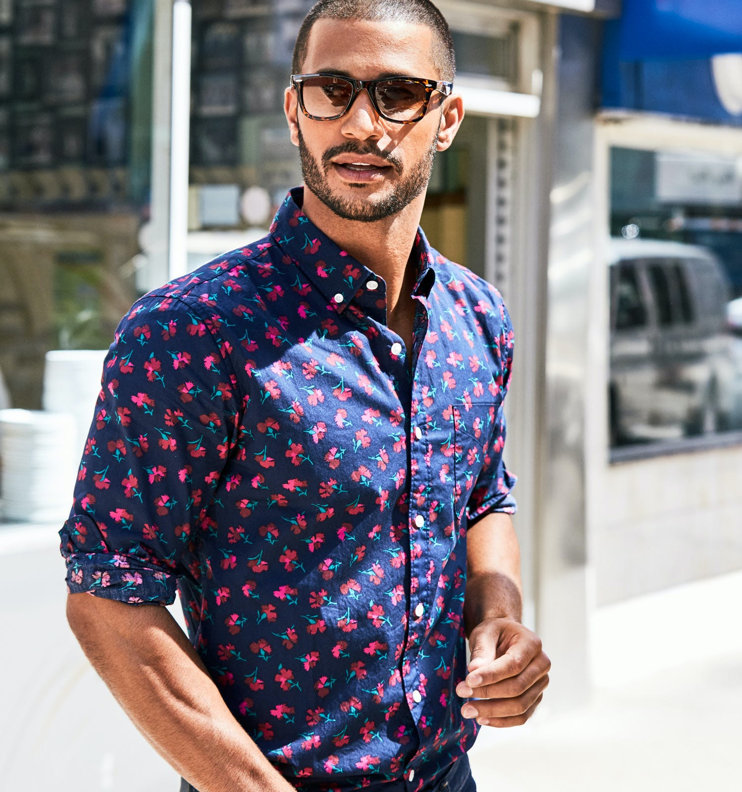 Photo of Man in Floral Shirt