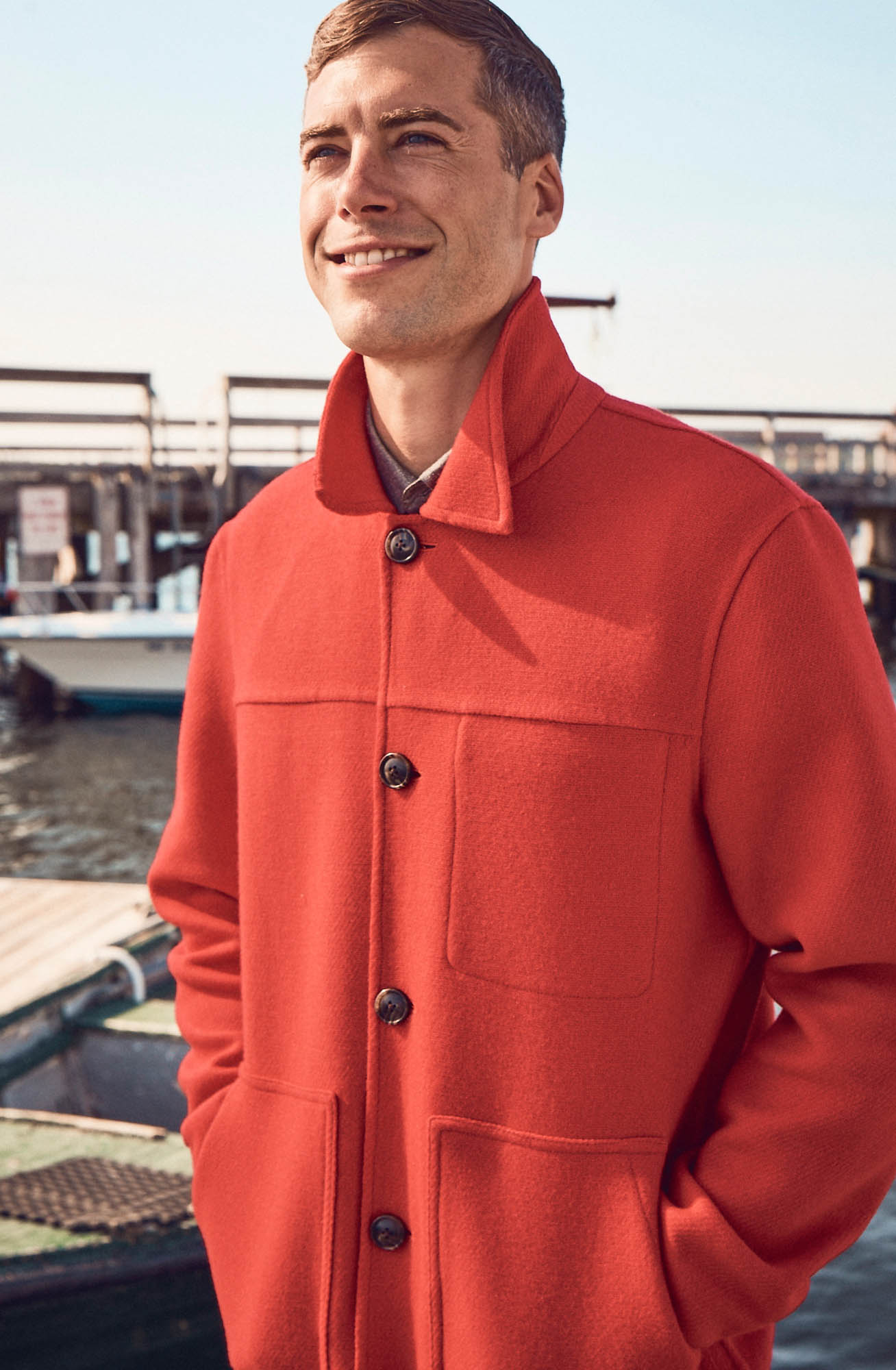 Brandon Sewall smiling in a red coat