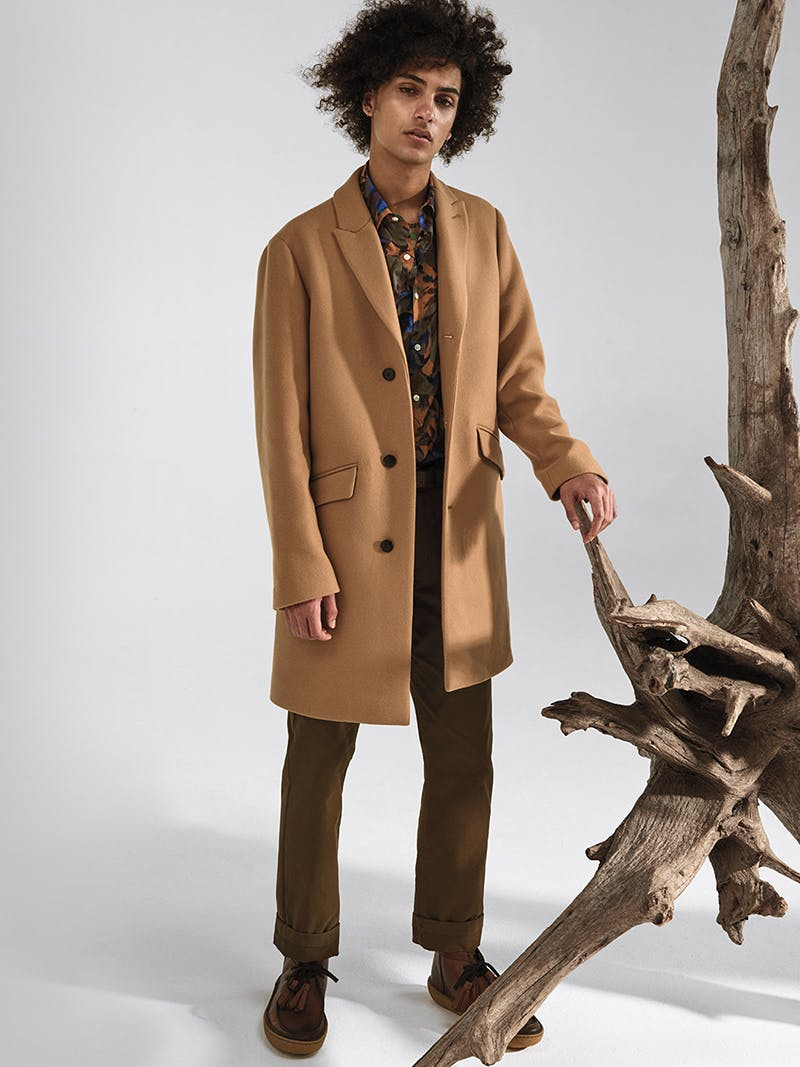 Image of man in a coat