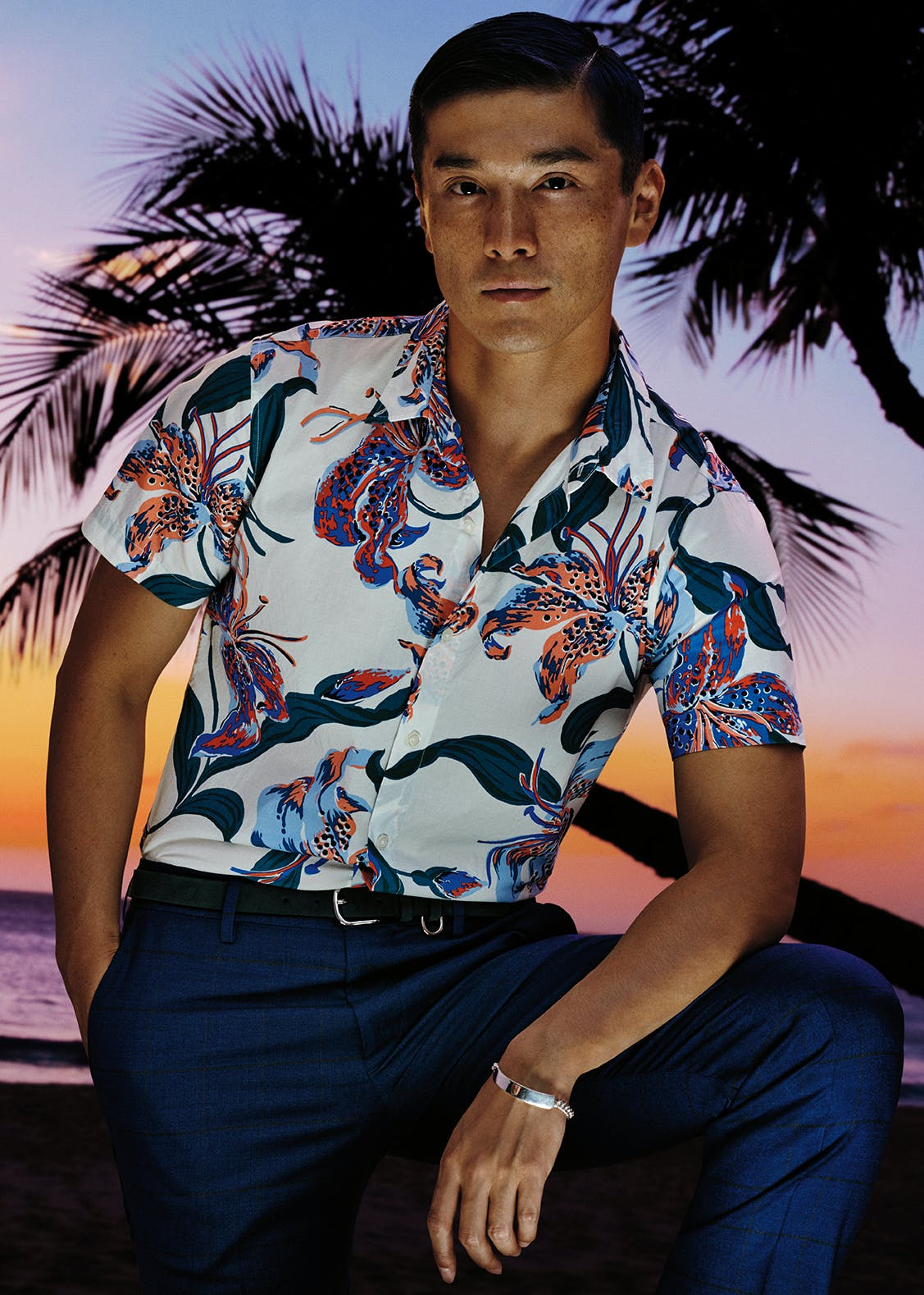 Man wearing Riviera Short Sleeve Shirt in Blue Exotic Floral