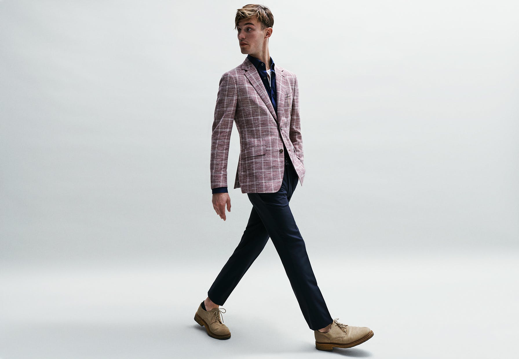 A blazer doesn't have to be stuffy; choose one with subtle color. This patterned option is in a muted red, best complemented by solid navy dress pants and shirts.