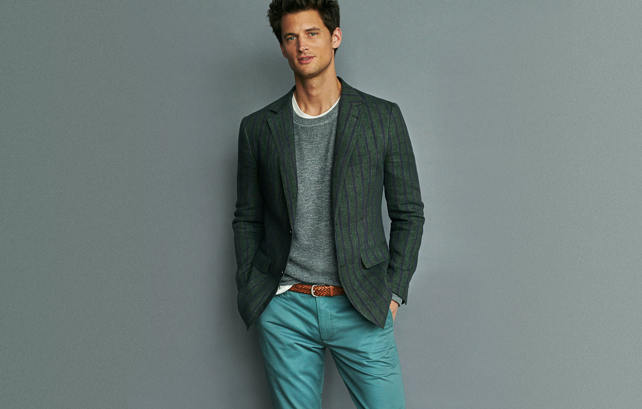 Want a look you can easily wear all season? Stick with tonal colors. These green-grey chinos are smart enough to pair with this green blazer and heather grey sweater.