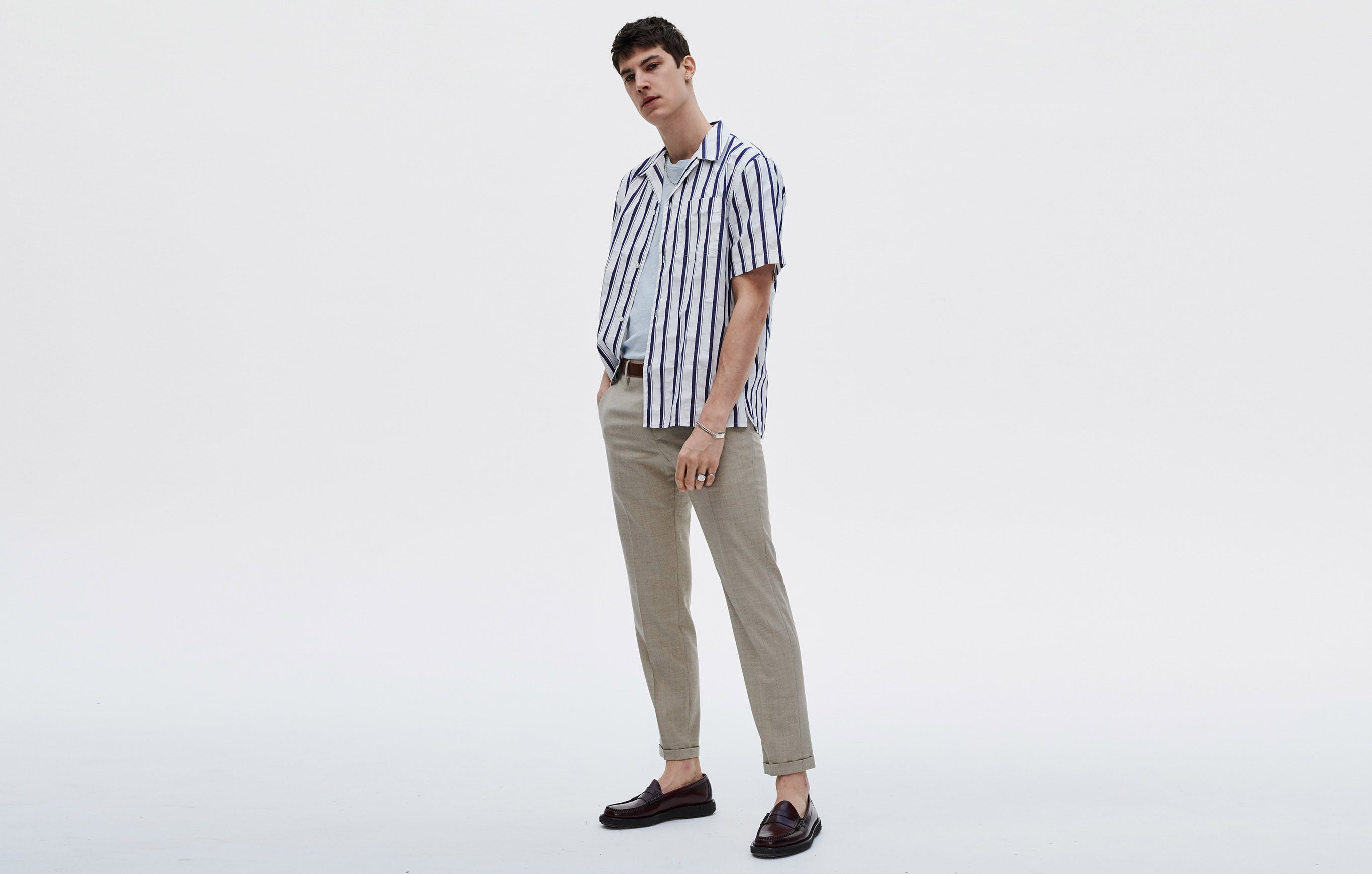Yes, the sleeves are shorter, but you'll still need a third piece. A layerable shirt fits the bill; wear it unbuttoned, so you can embrace the season and leave your jacket at home.