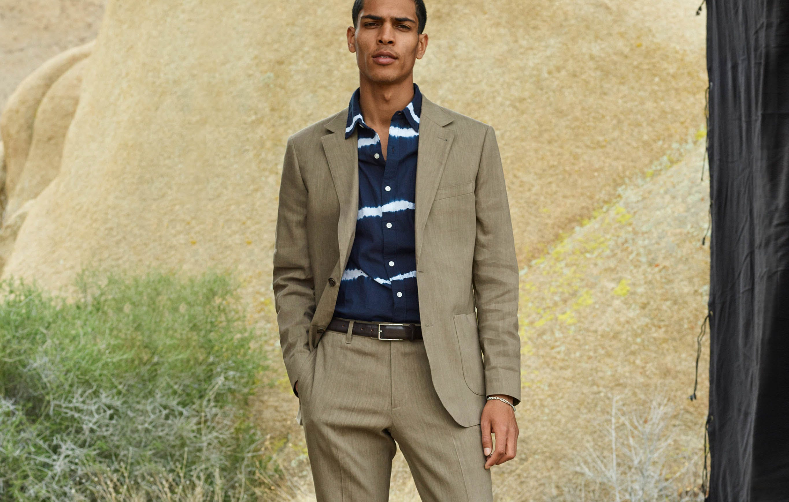 The white stripes on this navy Riviera were created by tying it off with strings and dipping it in a navy dye bath. Dress it up under this slightly casual brown suit for a sharp, but still relaxed, summer look.